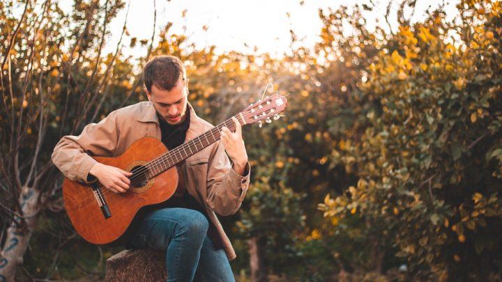 man learning guitar